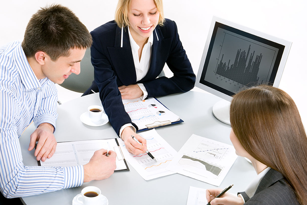 Four business people sitting around a table and having a busines