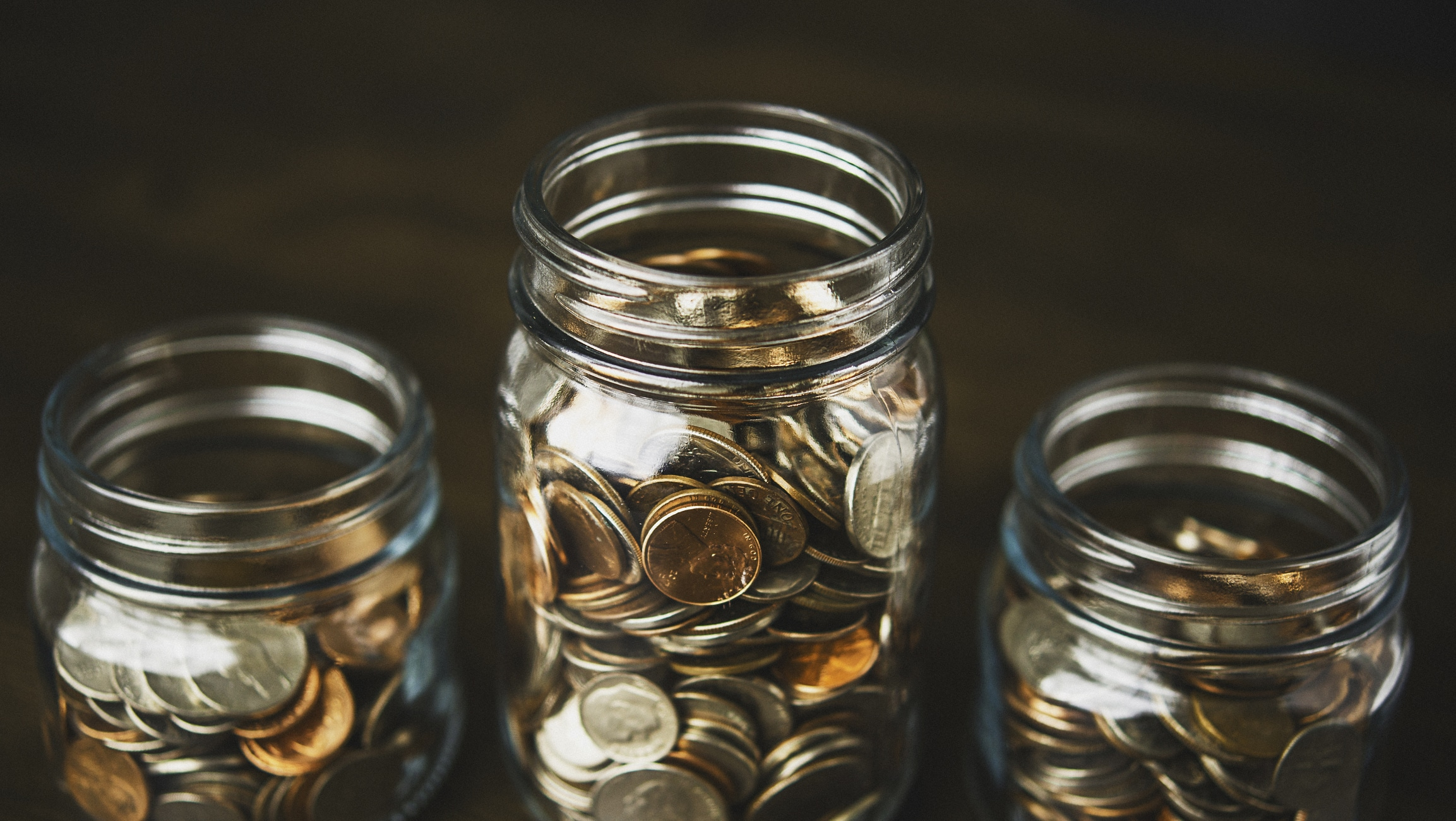 Money Jars Filled With American Currency Savings And Donations Concept Et Planning Corporation